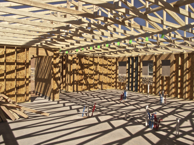 Interior of the house.  All the roof trusses in place. Roof sheathing and interior walls come next.