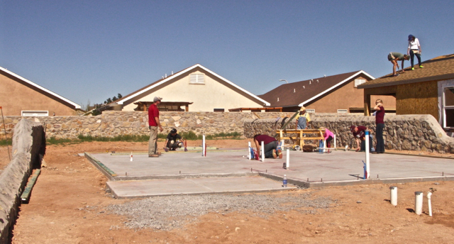 Saturday saw 26 workers, including NMSU students and future home owners. Some started laying out the foundation for the next house one lot over.