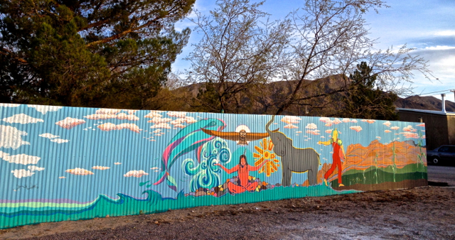 Hand-painted mural on metal sheeting